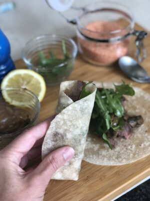 steak wrap and ingredients on cutting board